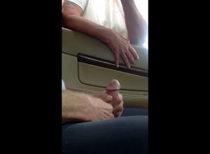 Showing and stroking penis in the car..