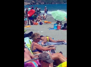 Eyed a lady jerking on a public beach