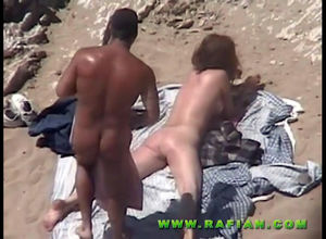 Naturist duo porks on beach in..